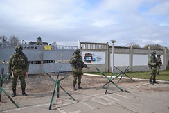 "Russian troops (""the polite people"") blocking the Ukrainian military base in Perevalne"