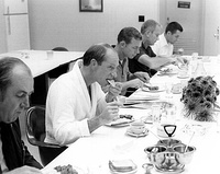 Several men at a sit-down breakfast