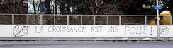 "Anti-WEF graffiti in Lausanne. The writing reads: La croissance est une folie (""Growth is madness"")."