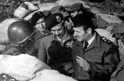 President Hafez al-Assad (right) with soldiers, 1973