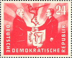 "1951 East German stamp commemorative of the Treaty of Zgorzelec establishing the Oder–Neisse line as a ""border of peace"", featuring the presidents Wilhelm Pieck (GDR) and Bolesław Bierut (Poland)"