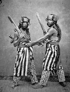 Indigenous Sasak dancers performing traditional Lombok wardance c.  1880