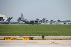C-130 on taxiway with C-17's parked in the background at Charleston Air Force Base (2014)