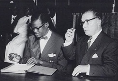 Lumumba and Eyskens sign the document granting independence to the Congo