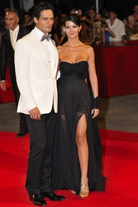 Red carpet fashion: Italian actors Gabriel Garko and Laura Torrisi wearing designer formal wear at Venice Film Festival, 2009