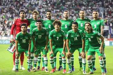 The Iraqi national team pose ahead of their 2019 AFC Asian Cup match against Iran in Dubai.