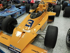 Johnny Rutherford won the Indy 500 and Pocono 500 in 1974 driving the McLaren M16C.