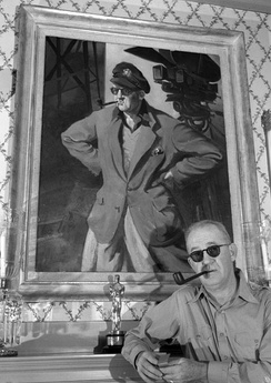 John Ford with portrait and Oscar, circa 1946