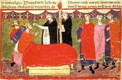 A crowned man lying in bed takes the Eucharist from two priest