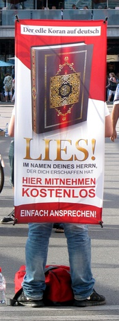 Proselytizer distributing copies of the Qur'an in Switzerland. (Lies! is German for Read!)