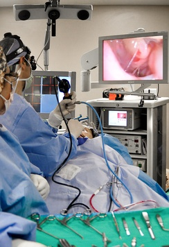Otolaryngologist performing an endoscopic sinus surgical procedure