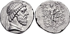 Two sides of a coin. The side on the left showing the head of a bearded man, while the right a standing individual.