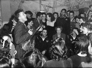 Pete Seeger entertaining Eleanor Roosevelt (center), at a racially integrated Valentine's Day party.[8]