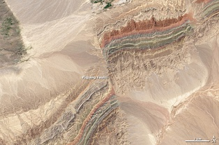 Satellite image of the Piqiang Fault, a northwest trending left-lateral strike-slip fault in the Taklamakan Desert south of the Tian Shan Mountains, China (40.3°N, 77.7°E)