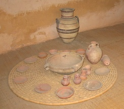 Food dishes, bowls and serving jugs shown in a reconstructed Israelite house.