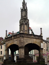 Open stone building on five pillars with a spire above.
