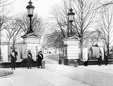 Suffragists calling themselves the Silent Sentinels picketing in front of the White House.