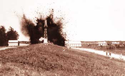 An Army Corps Photo of the levee at Caernarvon being dynamited during the floods of 1927.