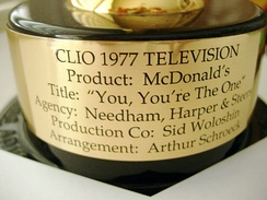 Engraved plaque on the 1977 Clio award given to Artie Schroeck for arranging the music in a McDonald's jingle.