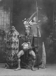 Dayak chief as seen holding a spear and a Klebit Bok shield.