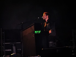 Make Trade Fair, abbreviated as MTF, shown on Chris Martin's piano during a concert