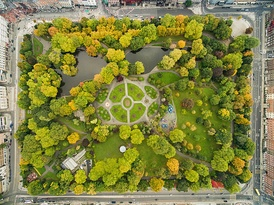 Aerial view of Dublin's St Stephen's Green, showing greenery, paths, and a pond, surrounded by buildings