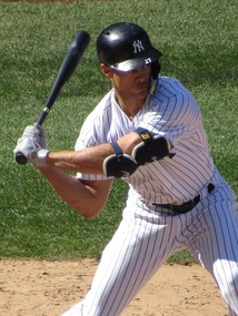 Stanton batting in April 2018, his first season with the Yankees