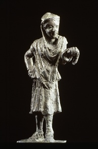 Bronze statue of a Greek actor. The half-mask over the eyes and nose identifies the figure as an actor. He wears a man's conical cap but female garments, following the Greek custom of men playing the roles of women.Later slave women were brought in to play minor female characters and in comedy as well.150-100 BC.