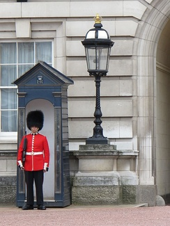 Sentry of the Grenadier Guards posted outside Buckingham Palace
