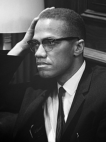 Malcolm X waiting for a press conference to begin on March 26, 1964