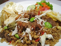 The ubiquitous nasi goreng (fried rice), considered one of Indonesia's national dishes, it has rich variants, this one uses green stinky bean and goat meat.