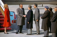 President Nixon shakes hands with Chinese Premier Zhou Enlai upon arriving in Beijing, 1972