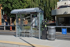The amenities at each streetcar stop include a small shelter (with interior information display), ticket vending machine and trash can.