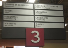 Bilingual sign in a Quebec supermarket with markedly predominant French text