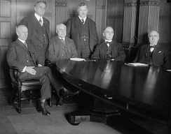Railway Wage Commission with a seated James Harry Covington, Franklin Knight Lane, Charles Caldwell McChord, and William Russell Willcox. Standing are William A. Ryan and Frederick William Lehmann.