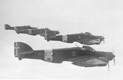 A flight of four Italian Savoia-Marchetti SM.79 Sparviero trimotor bombers, each with a similar gondola behind the bomb bay, but primarily used for the bombardier on this design, because of the nose-mounted engine taking up a bombardier's usual location