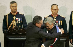 President Sebastian Piñera receives the presidential sash from Senate President Jorge Pizarro at the National Congress of Chile on 11 March 2010.