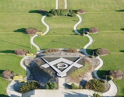 The Square and Compasses, a large Masonic symbol built of concrete, was added to the memorial in 1999.