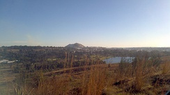 A view from Coronation Park overlooking the old town with the West Rand Consolidated Mines dump on the horizon