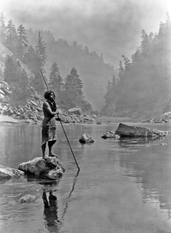 A photograph of an American native, a Hupa man with his spear – by Edward Sheriff Curtis, dated 1923
