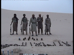 Al-Qaida in Magreb members pose with weapons.
