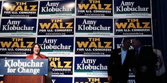 Klobuchar with Barack Obama and Tim Walz.