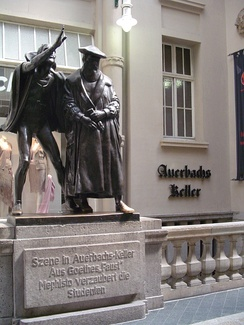 "Sculpture of Mephistopheles bewitching the students in the scene ""Auerbachs Keller"" from Faust, at the entrance of what is today the restaurant Auerbachs Keller in Leipzig."