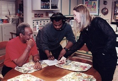 Cosby, a production assistant, and Ginna Marston of Partnership for Drug-Free Kids review the script for a 1990 public service spot at Cosby's studio in Astoria, Queens.