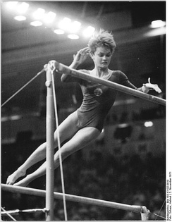 Karin Janz on uneven bars.