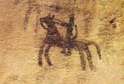 Prehistoric cave painting, depicting a horse and rider