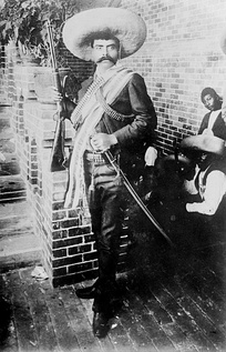 With rifle and sword, General Emiliano Zapata, leader of revolutionaries in Morelos beginning in 1911 and ending in his assassination in 1919, (Archivo General de la Nación, Mexico City, Archivo Fotográfico Díaz, Delgado y García)