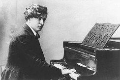 Busoni at the piano, from a postcard produced c. 1895–1900.