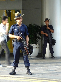 A Gurkha Contingent trooper in Singapore armed with a folding stock pump shotgun