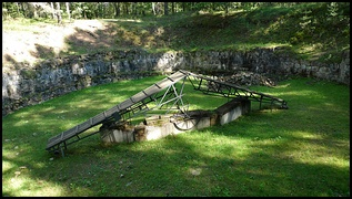 Pit used to burn corpses that were exhumed to destroy evidence of mass murders.